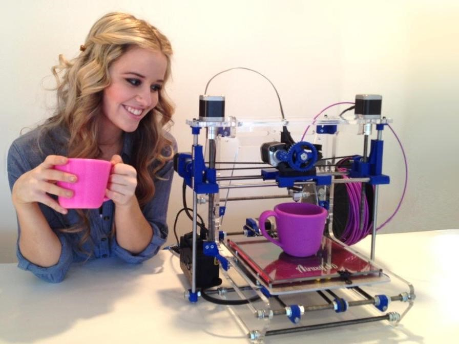 Woman making cups with 3d printer