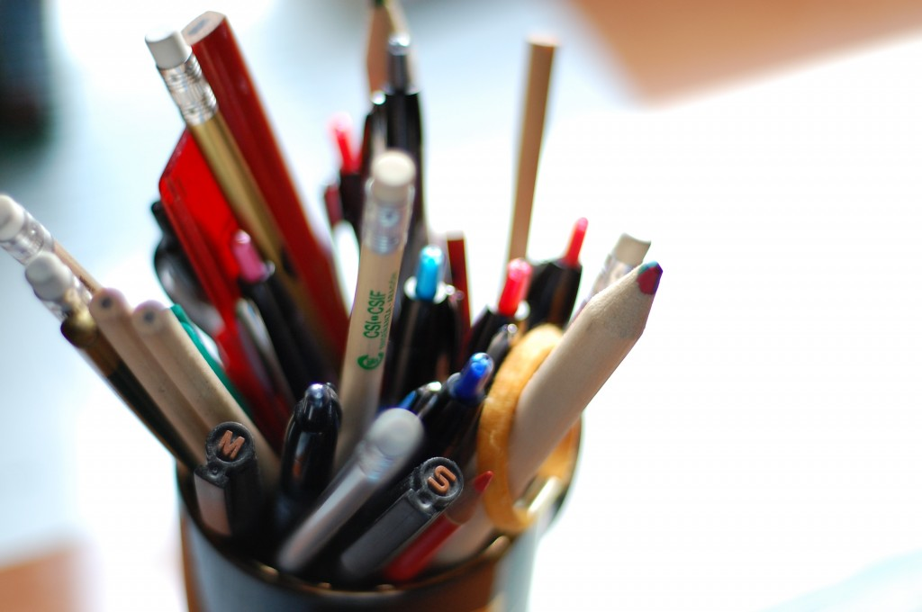 A cup of pens and pencils