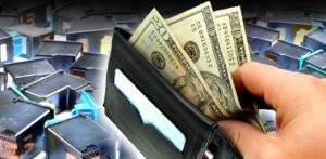 dollar bills in wallet over ink cartridges