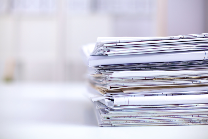 Big stack of papers ,documents on the desk .